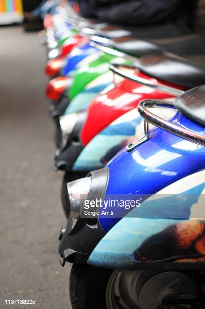 Row of colourful mopeds