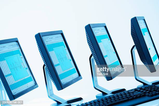Row of computer monitors, with keyboard