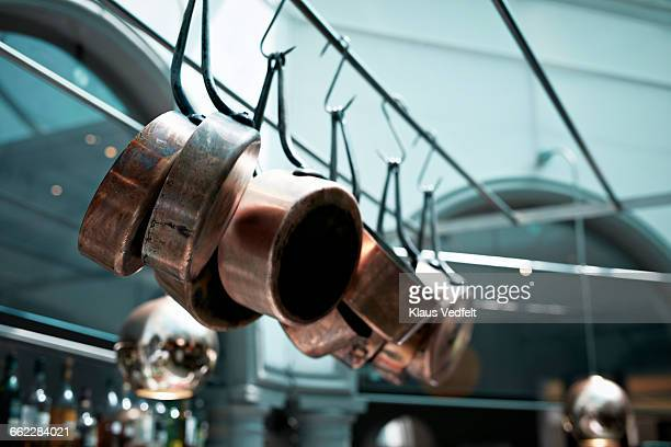 row of copper pots & pans in open kitchen - saucepan stock pictures, royalty-free photos & images