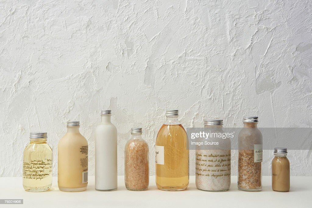 Row of cosmetics bottles : Stock Photo