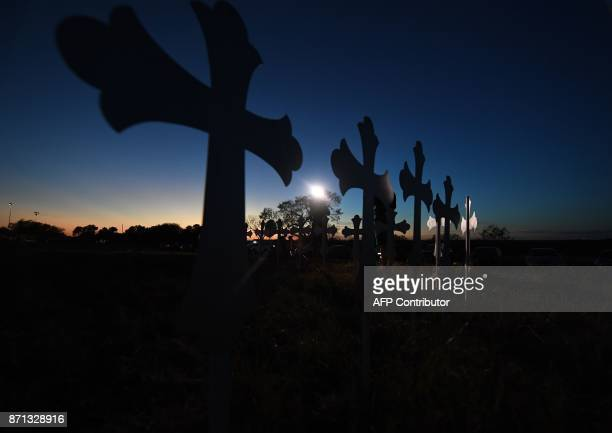 A row of crosses for each victim has been placed at a memorial after a mass shooting that killed 26 people in Sutherland Springs Texas on November 6...