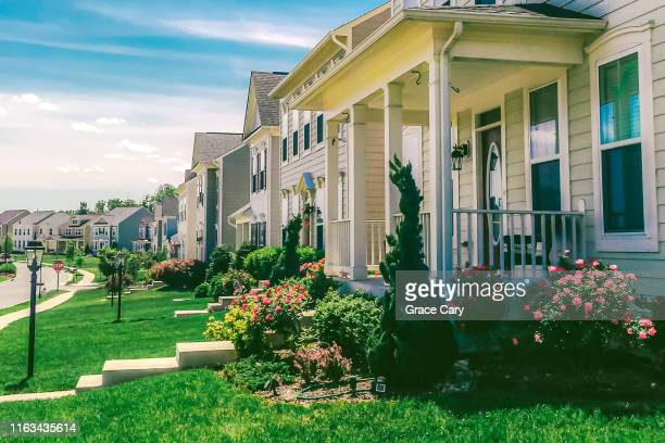 row of detached homes in idyllic community - residential district stock pictures, royalty-free photos & images