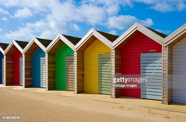 Row of different coloured beach huts Blyth Northumberland 2010 Artist Historic England Staff Photographer