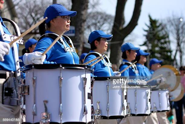 Row of drummers marching in a parade