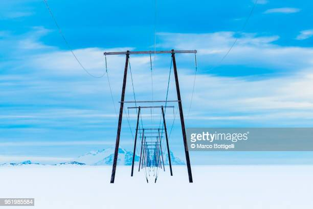 Row of electricity pylons in perspective, Iceland.