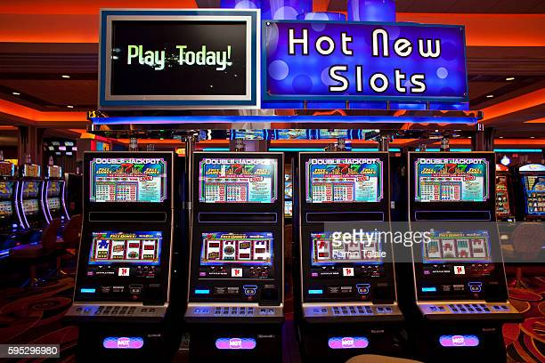 A row of electronic slot machines in the main hall of Genting's new Resorts World New York casino at Aqueduct Race Track in Jamaica section of Queens...