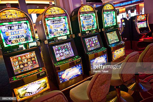 A row of electronic slot machines inside of Genting's new Resorts World New York casino at Aqueduct Race Track in Jamaica section of Queens in New...