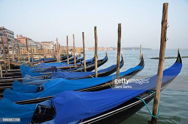 Row of empty moored gondolas, Venice, Italy, Europe