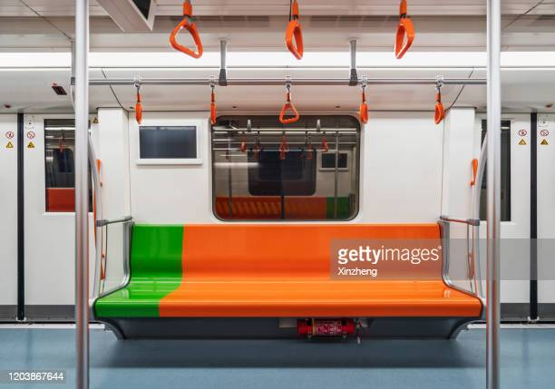 row of empty orange seats in train subway - 地下鉄 ストックフォトと画像