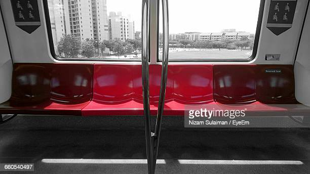 Row Of Empty Red Seats In Train Subway
