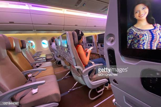 A row of empty seats are seen on board a Singapore Airlines flight to Singapore from Jakarta International Airport before the aircraft's departure...