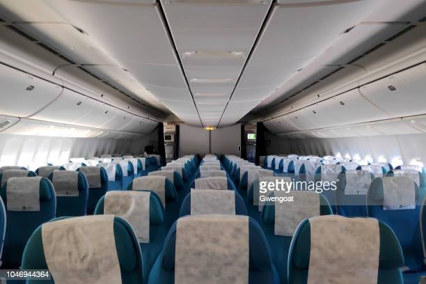 row of empty seats in a boeing 777 - boeing stock pictures, royalty-free photos & images