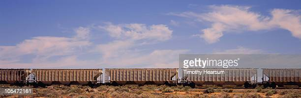 row of empty train hopper cars  - timothy hearsum stockfoto's en -beelden