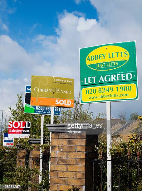 row of estate agents signs - telephone number stock pictures, royalty-free photos & images