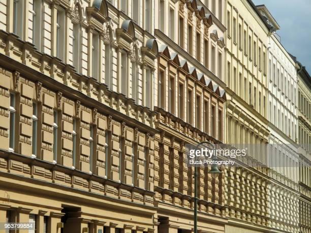 row of facades of buildings in the east berlin district of prenzlauerberg, berlin - プレンツラウアーベルグ ストックフォトと画像