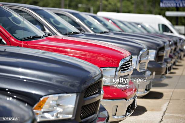 A row of Fiat Chrysler Automobiles 2017 Dodge Ram trucks are displayed for sale at a car dealership in Moline Illinois US on Saturday July 1 2017...