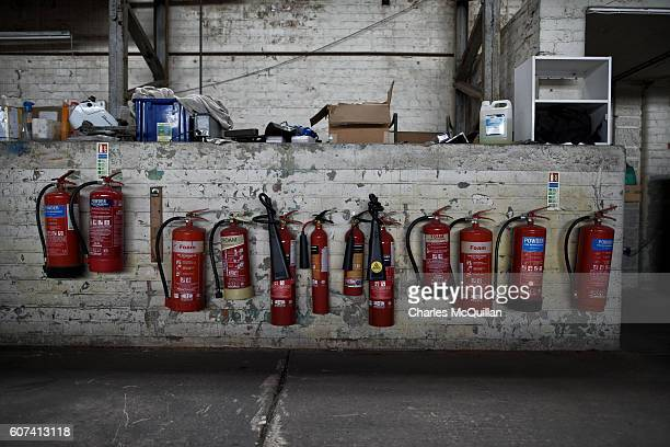 A row of fire extinguishers can be seen as work continues on the Ferguson monoplane on September 18 2016 in Lisburn Northern Ireland The Ulster...