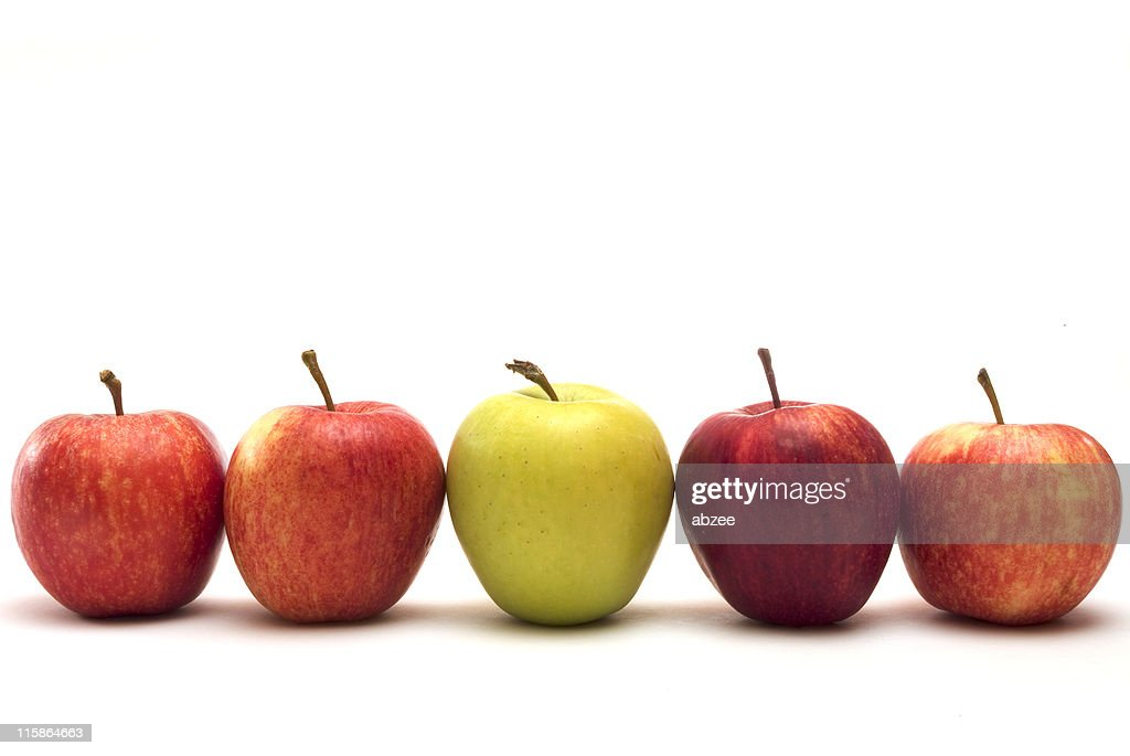 Row of five apples with different colors on a white surface : Stock Photo
