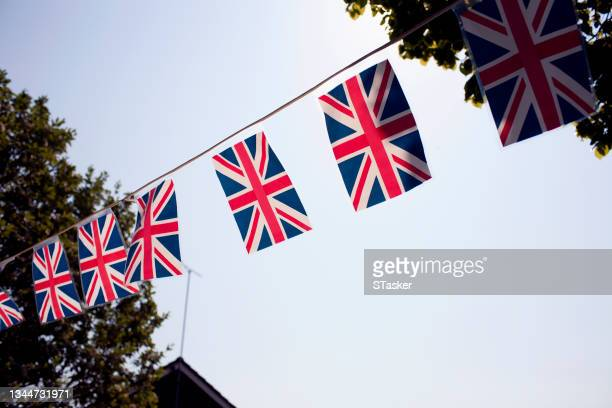 row of flags - st. albans stock pictures, royalty-free photos & images