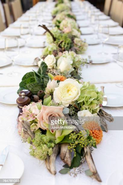 Row of flowers on table