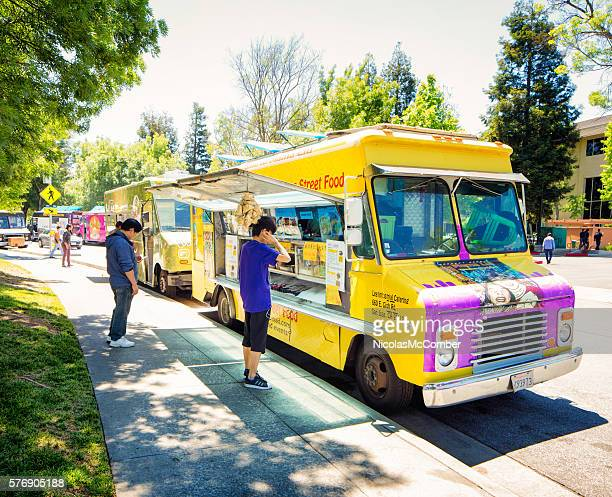 Row of food trucks open for lunch in Silicon Valley