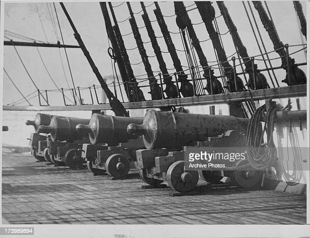 A row of four 'old ironside' guns or the 'big boys' of the US Navy as seen on the deck of the USS Constitution during the War of 1812