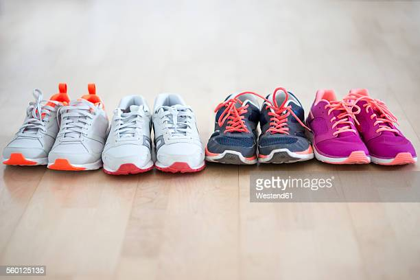 row of four pair sneakers - pair stock pictures, royalty-free photos & images