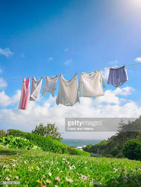 Row of fresh laundry on clothes line in coastal garden