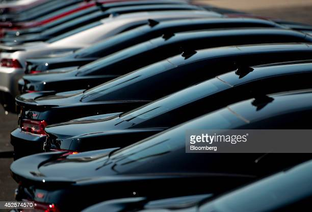 A row of General Motors Co 2014 Chevy Camaro vehicles sit on the lot at Webb Chevrolet dealership in Plainfield Illinois US on Wednesday July 23 2014...