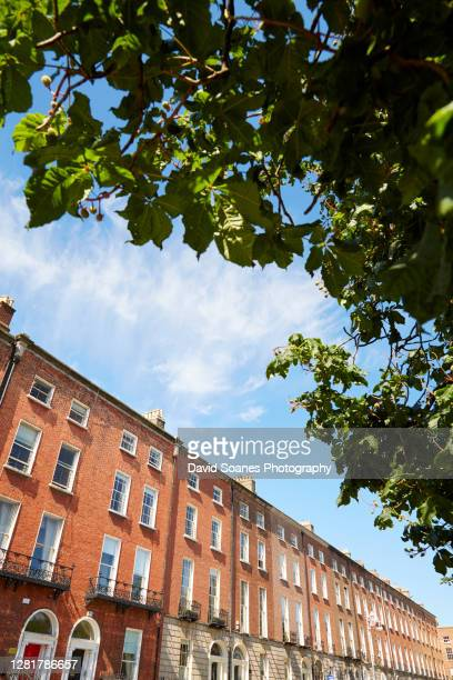 a row of georgian buildings in dublin city, ireland - david soanes stock pictures, royalty-free photos & images