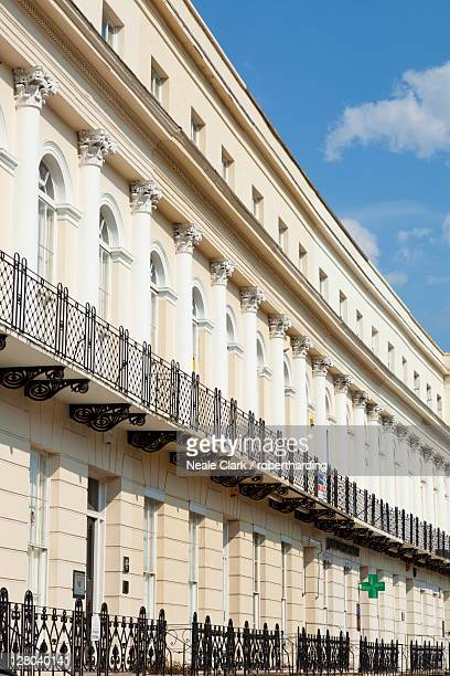 Row of Georgian Regency style terraced houses on St. Georges Road, Cheltenham Spa, Gloucestershire, England, United Kingdom, Europe