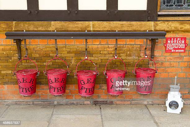 Row of G.E.R. fire buckets