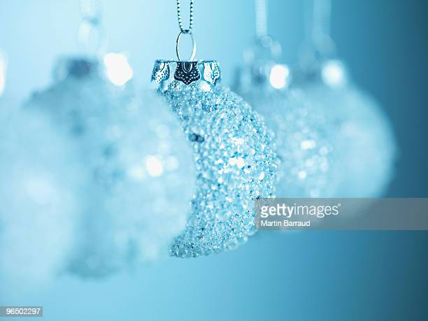 Row of glass Christmas ornaments