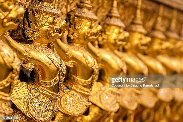row of golden garuda figures in the wat phra kaew, thailand. - grand palace bangkok stock pictures, royalty-free photos & images
