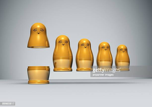 Row of golden Russian Dolls