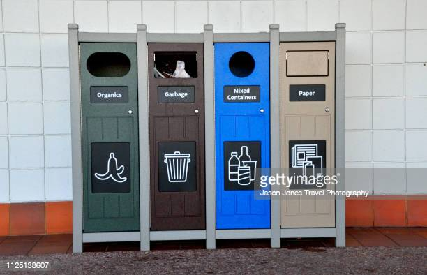 row of green recycling bins - recycling bin stock pictures, royalty-free photos & images