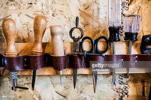 Row of hand tools on workshop wall