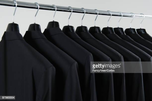 Row of hanging suits