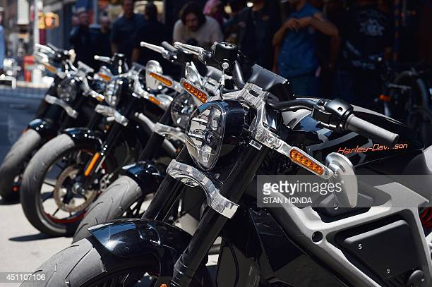 A row of HarleyDavidson Project LiveWire motorcycles the company's first electric motorcycle during a preview June 23 2014 outside a HarleyDavidson...