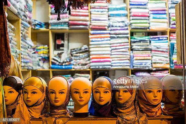 A row of head scarfed mannequins in Fez medina