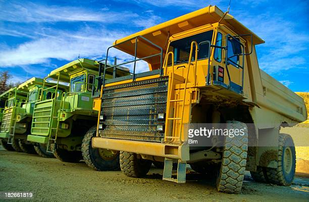 Row of heavy duty dump trucks