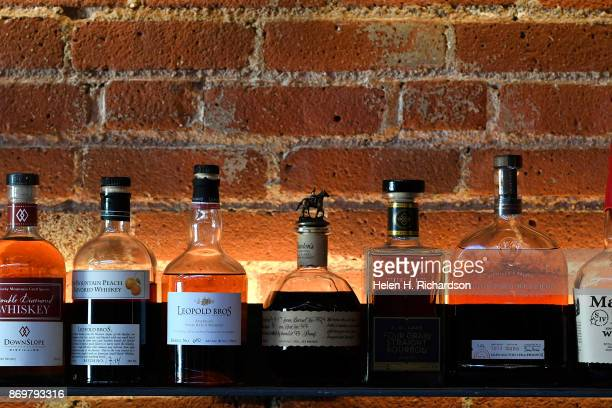 DENVER CO OCTOBER 24 A row of high quality whiskey is on display at the new bar called SneekEazy on October 24 2017 in Denver Colorado SneekEazy with...