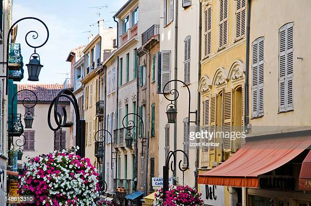 row of houses along street in old antibes. - antibes stock photos and pictures