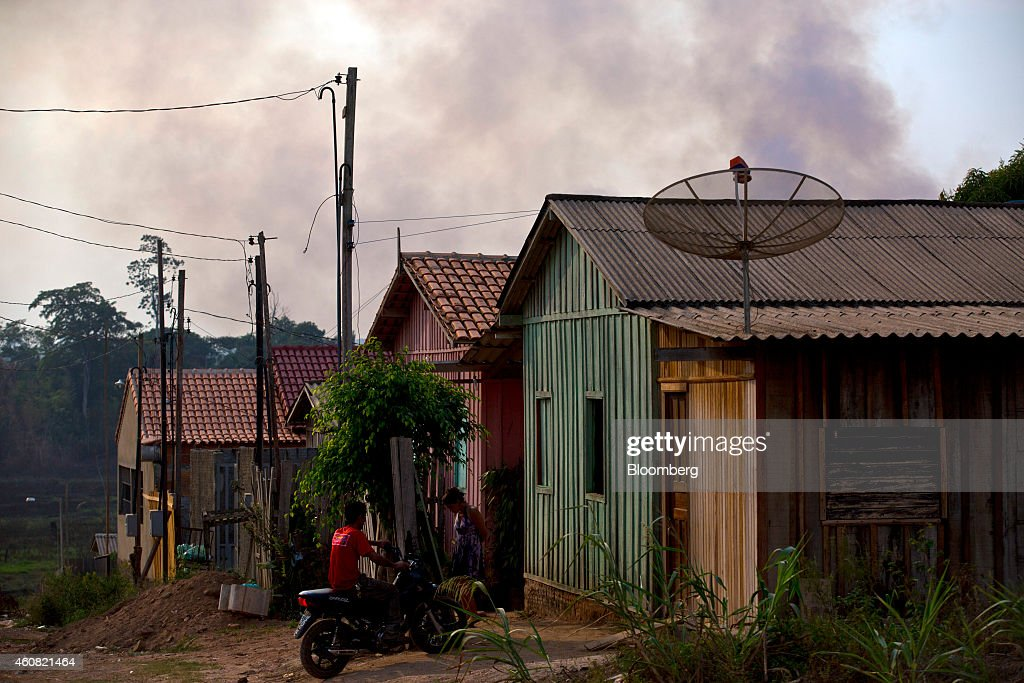 A row of houses for workers stands near a sawmill in Anapu, Brazil, on Thursday, Dec. 18, 2014. The rate of deforestation Brazil's Amazon rain forest dropped 18 percent over the last year, according to a report by the country's environment minister in November. Photographer: Dado Galdieri/Bloomberg via Getty Images