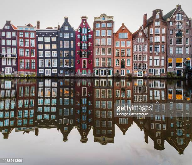 row of houses in amsterdam, the netherlands - amsterdam stock pictures, royalty-free photos & images