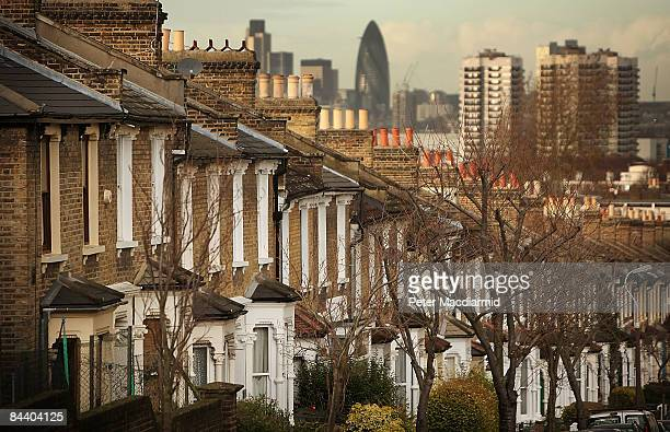 A row of houses lies in sight of Canary Wharf viewed from south London on January 22 2009 in England The number of repossession orders is up 92 per...
