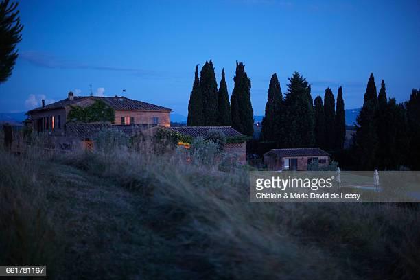 Row of houses on hillside, Buonconvento, Tuscany, Italy