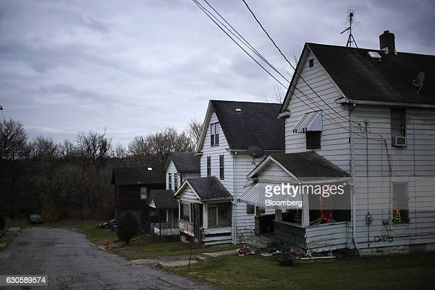 A row of houses stand along a residential street in Youngstown Ohio US on Tuesday Dec 1 2016 The conventional wisdom among election observers and...