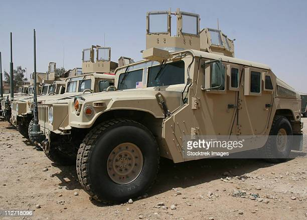 a row of humvees from task force military police. - armored vehicle stock pictures, royalty-free photos & images
