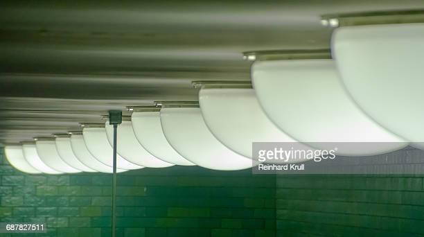 Row Of Illuminated Recessed Lights On Ceiling